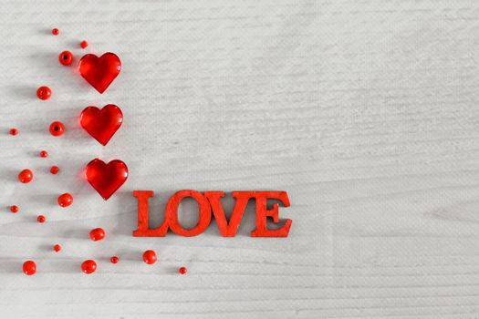 Layout, hearts and the word love on a wooden background. Valentine's Day. High quality photo