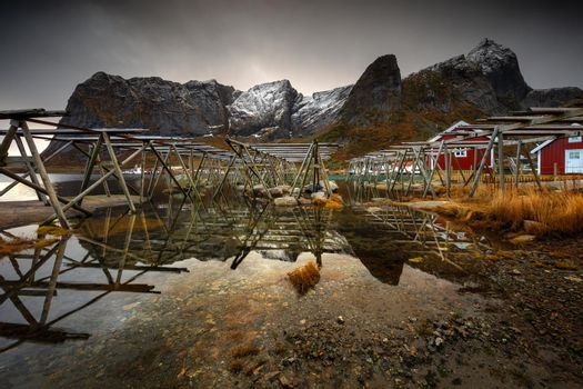 Landscape of a Fishing Village in Norway. Construction for Drying Fish on the bank. Traditional Job in Norwegian Countrysides.