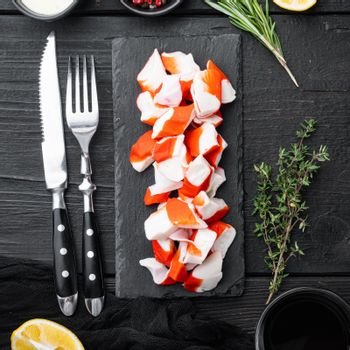 Fresh Crab meat surimi with blue swimming crab, on black wooden table background, top view flat lay