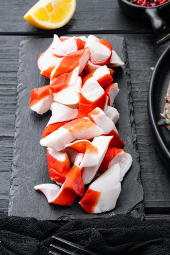 Fresh Crab meat surimi with blue swimming crab, on black wooden table background