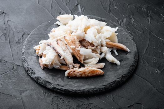 Mixed brown white crabmeat boiled set, on black background