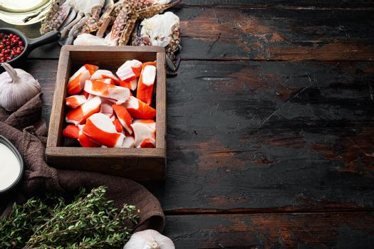 Fresh Crab meat stick surimi , in wooden box, on dark wooden background , with copyspace and space for text