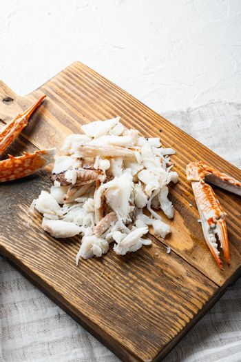 Boiled crab food, on wooden cutting board, on white background