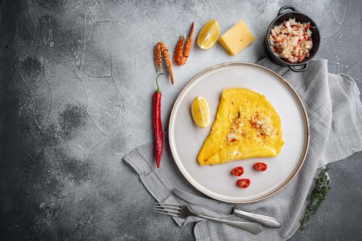 Chilli crab silky omlette , on plate, on gray background, top view flat lay , with copyspace and space for text