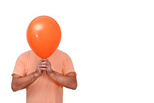 A man holds a balloon in front of his head. The balloon is like a mask. Isolated on a white background. copy space