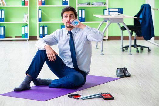Employee doing exercises during break at work