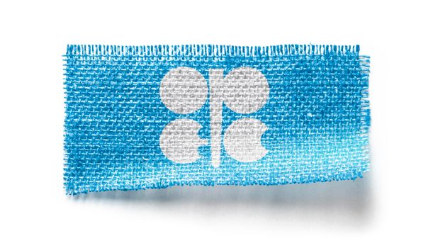 Organization of the Petroleum Exporting Countries flag on a piece of cloth on a white background