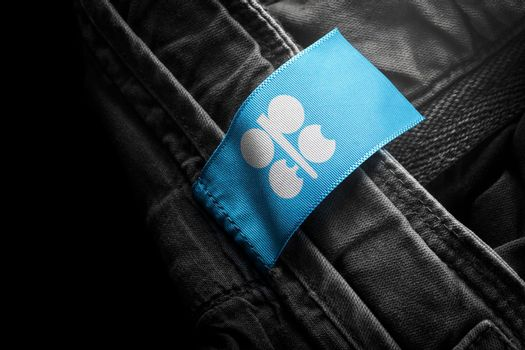 Tag on dark clothing in the form of the flag of the Organization of the Petroleum Exporting Countries