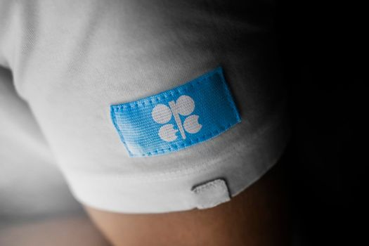 Patch of the national flag of the Organization of the Petroleum Exporting Countries on a white t-shirt
