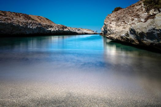 Beautiful Landscape of a Blue Lagoone in Mediterranean Sea. Great Rocks on the Beach. Amazing Picturesque View. Luxury Summer Holidays in Greece.