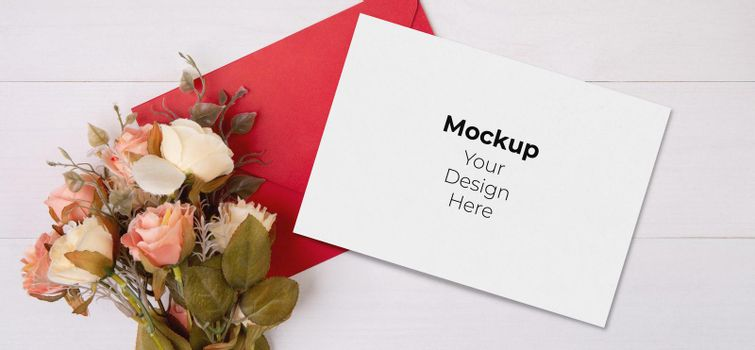 Valentine day, greeting card mockup and letter and flower on wooden table, postcard blank and with romance on desk, present in anniversary and celebration, top view, holiday concept.