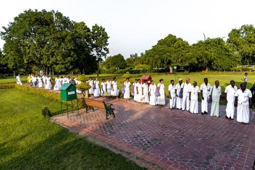 Srilankan devotees standing in queue to observe the birth place of Buddha at Lumbini, Nepal