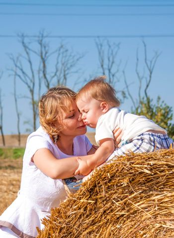 Live emotions of mother and son. A small child and a woman experience the feelings of love of mother and son.