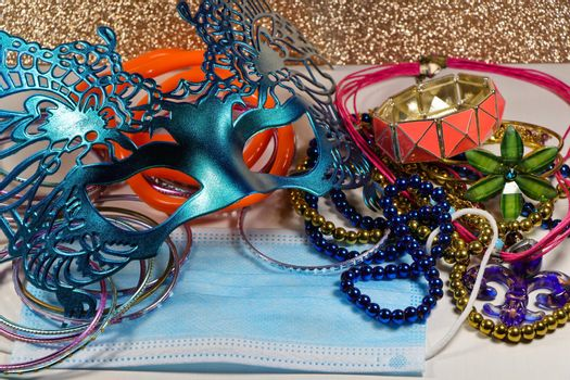 Mardi Gras carnival theme parade mask and jewelry with medical facemask on white