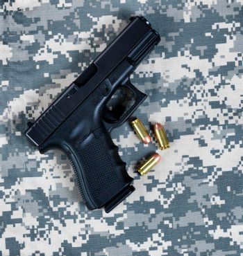 Military pistol for the holidays of Memorial, 4th of July and Veteran Day