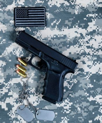 US flag, pistol and ID tags for Memorial, 4th of July and Labor Day holiday