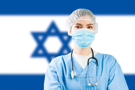 Portrait of a caucasian doctor with flag of Israel in background, COVID-19 virus disease crisis, Coronavirus global worldwide pandemic, social distancing isolation and quarantine concept