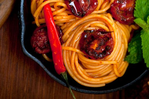 italian spaghetti pasta and tomato with mint leaves