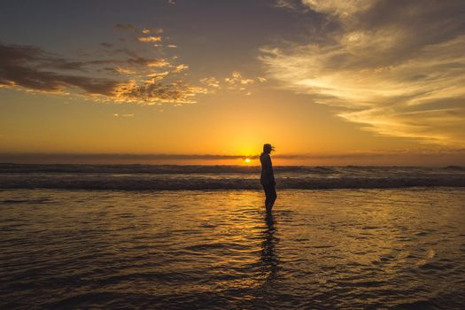 carefree woman dancing in the sunset on the beach. vacation vitality healthy living concept, Australia