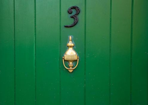 House number 3 with brass knocker