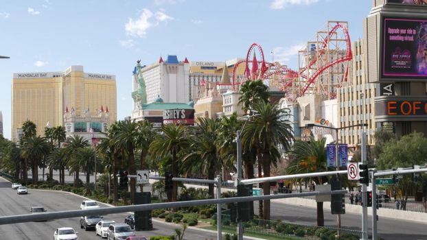 LAS VEGAS, NEVADA USA - 7 MAR 2020: The Strip boulevard with luxury casino in gambling sin city. Car traffic on road to Fremont street, tourist money playing resort. New York hotel and Liberty Statue