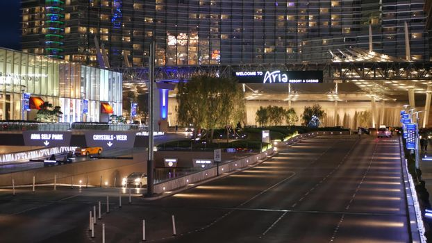LAS VEGAS, NEVADA USA - 5 MAR 2020: Futuristic CityCenter casino complex, sin city glowing at night. Modern illuminated luxury hotel, unincorporated urban skyline. Contemporary metropolis skyscrapers