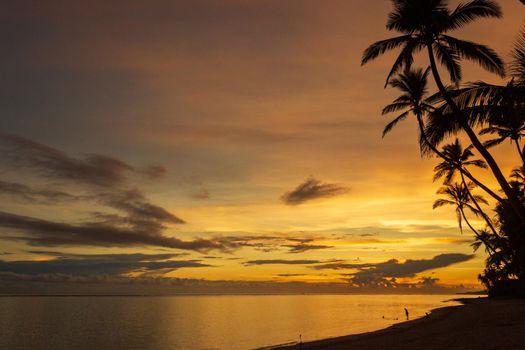 Colorful sunrise on Tambua Sands Beach on Fiji Island, Fiji