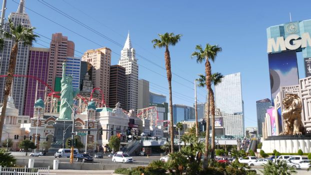 LAS VEGAS, NEVADA USA - 8 MAR 2020: The Strip boulevard with luxury casino in gambling sin city. Car traffic on road to Fremont street, tourist money playing resort. New York hotel and Liberty Statue