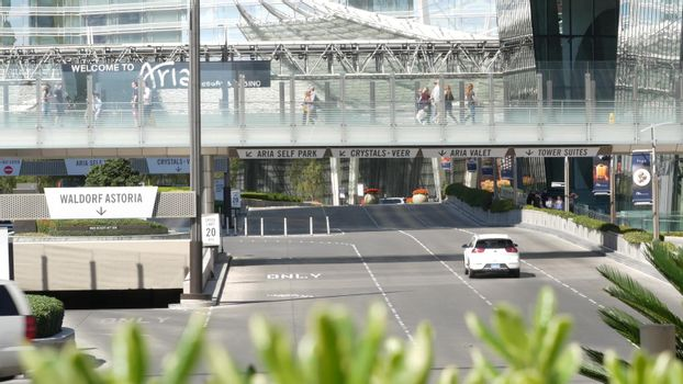 LAS VEGAS, NEVADA USA - 7 MAR 2020: Futuristic CityCenter casino complex in sin city downtown. Modern luxury unincorporated urban skyline. Contemporary metropolis highrise skyscrapers and pedestrians