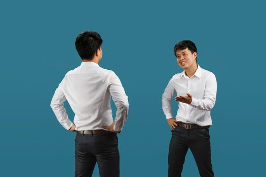 Two employee having a confrontation , isolated on blue background