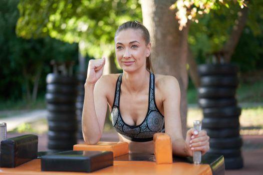Sportive female arm wrestling outdoor gym summer park