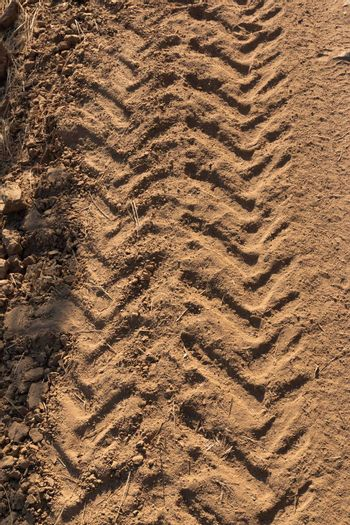 Tractor tracks on arid and dry terrain in southern Andalusia in Spain