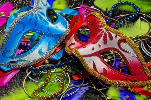 Mardi Gras red and blue carnival face masks with vibrant feathers and jewelry theme