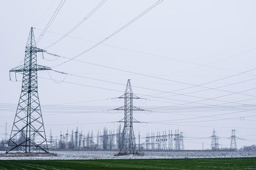 transmission of large amounts of electricity. towers of high-voltage wires. High quality photo