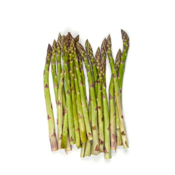 Bunch of fresh raw garden asparagus isolated on white background. Green spring vegetables. Top view of edible sprouts of asparagus.