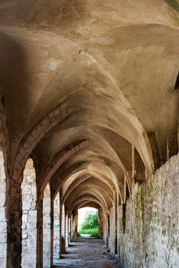 Ancient alley with brick archts in old town of San Nicola Island, Tremiti Islands, Italy