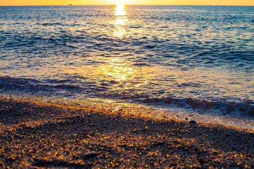 Evening on the seaside. Beautiful sunset. Tyrrhenian Sea sunset in Calabria, Italy.
