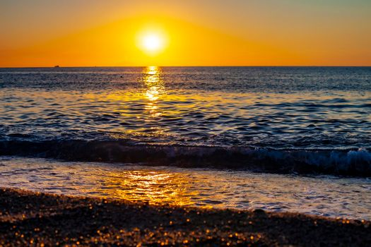 Red sunset over the sea. Beautiful sunset. Tyrrhenian Sea sunset in Calabria, Italy.