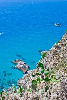 Overview of rock stone coast. Calabria, Italy: scenic view of tipycal rocky coastline. Thyrrenian Sea. Cape Capo Vaticano, Calabria, Southern Italy.