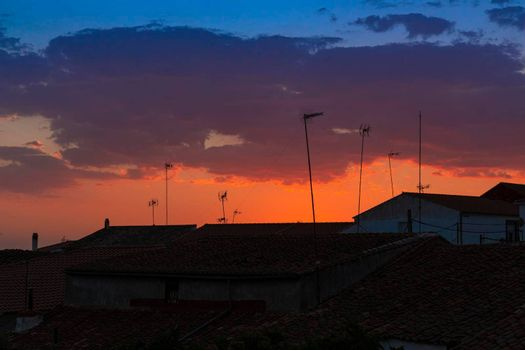 Sunset in a town in southern Andalusia, with beautiful shades of orange and blue