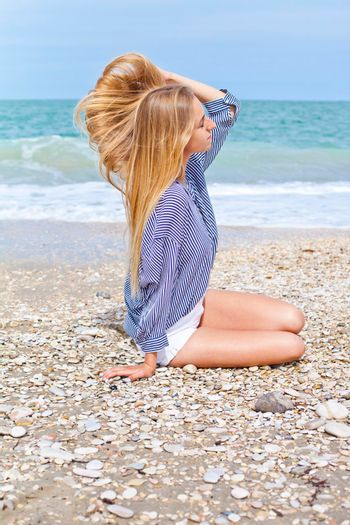 Beautiful happy girl on the Adriatic beach. Travel and vacation.