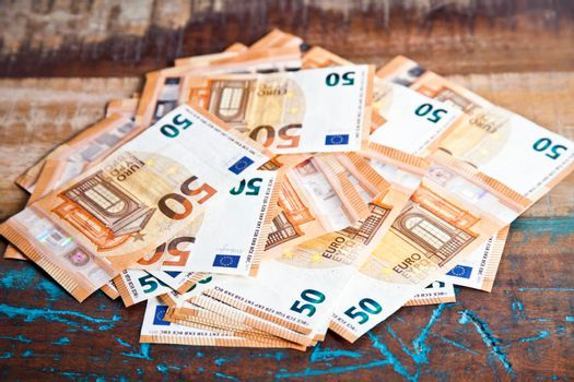 Pile of fifty euro banknotes.