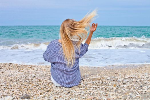 Beautiful girl in sea style on the Adriatic beach. Travel and vacation. Freedom Concept.