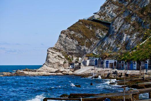 Blue sea water, stones and rocks on Adriatic sea coast.