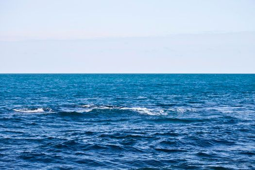 Waving water surface of the Adriatic sea and sky.