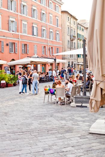 Ancona, Italy - June 8 2019: People enjoying summer day and food at outdoor restaurant and resting, Piazza del Plebiscito, Ancona, Italy