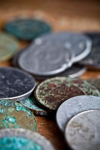 Tarnished and partially corroded old copper coins