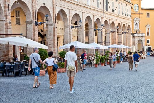 Fermo, Italy - June 23, 2019: People enjoying summer day and food at outdoor restaurant and resting, Piazza del Popolo, Fermo, Italy