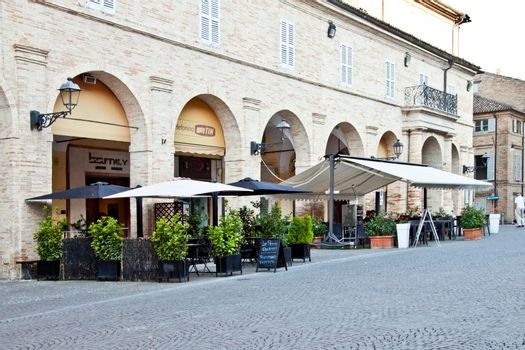 Fermo, Italy - June 23, 2019: Summer day and utdoor restaurant. Piazza del Popolo, Fermo, Italy