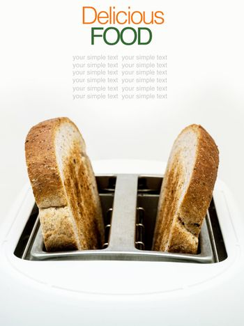Toasted bread and toaster for breakfast.